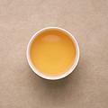 茶汤黄色偏红,茶汤颜色变深,仍有花香,茶汤滋味醇和,显苦底但整体滋味协调。