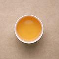 茶汤变为深黄色,颜色变深,复合花香,香气馥郁,滋味醇厚,收敛性,稍带涩味,回甘。