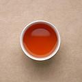 汤色较上泡变浅,浅橙红较亮,;糊味明显,茶汤滋味淡薄,有苦味。