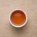 汤色橙红,色泽略浑浊,茶汤带明显发酵气味,滋味微甜,略涩。